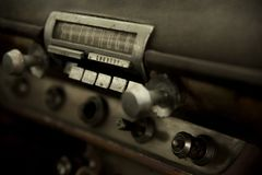 close up of old push button radio in dashboard of old junk vintage car Stock Images