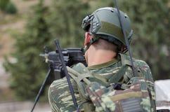 Radio operator gunner M249  light machine gun. Radio operator gunner with light machine gun m 249 Stock Photos
