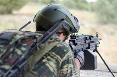 Radio operator gunner M249  light machine gun. Radio operator gunner with light machine gun m 249 Royalty Free Stock Images