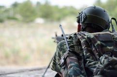 Radio operator gunner M249  light machine gun. Radio operator gunner with light machine gun m 249 Stock Image