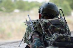 Radio operator gunner M249  light machine gun. Radio operator gunner with light machine gun m 249 Stock Photo