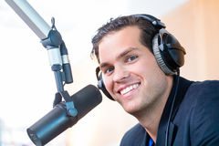 Radio presenter in radio station on air. Presenter or host in radio station hosting show for radio live in Studio Stock Photography