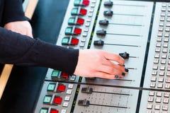 Radio presenter in radio station on air. Presenter in radio station hosting show for radio live in Studio royalty free stock image