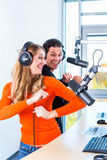 Radio presenters in radio station on air Stock Image