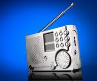 Radio receiver. On a blue background Stock Photos