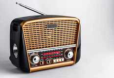 Radio receiver in retro style with audio player and flashlight on white background Royalty Free Stock Image