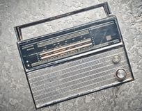 Radio receiver from 70s on a gray concrete background. Top view Royalty Free Stock Photos