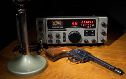Radio and revolver Royalty Free Stock Image