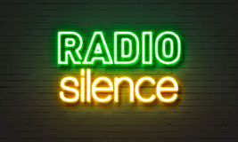 Radio silence neon sign on brick wall background. Stock Image