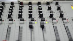 Radio station. Professional multitrack mixing console, computer and microphone in the control room. Recording and broadcasting pro