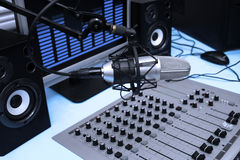 In radio studio. A mic in front of the control panel and screen in broadcasting studio Stock Photos