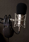 Radio studio. Microphone and big headphone Royalty Free Stock Photography