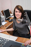In radio studio. A DJ is in front of a mic in the broadcasting studio Stock Images