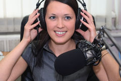 In radio studio. A radio DJ with headphones in the broadcasting studio stock images