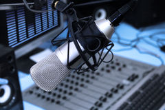 In radio studio. A mic in front of the control panel in broadcasting studio royalty free stock image