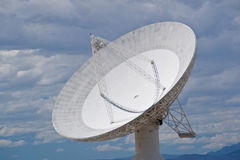 Radio Telescope. A large radio telescope dish eplores space from the California desert royalty free stock images