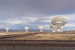 Radio Telescope Array with rails Royalty Free Stock Photos