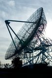Radio telescope dish. Against the sun stock images