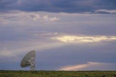 Radio telescope dish alone in field Stock Image