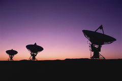Radio telescope dish field in twilight Royalty Free Stock Image