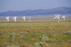 Radio telescope dishes in field Royalty Free Stock Photo