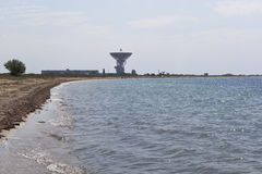 Radio telescope for distant space communication on the Black Sea coast near Molochnoe settlement in Saki district, Crimea Royalty Free Stock Photo