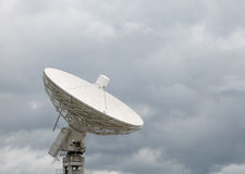 Radio telescope pointing at stormy sky Royalty Free Stock Photos