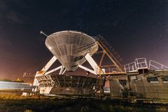 Radio telescope satellite antenna at starry night royalty free stock images