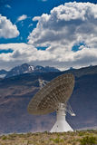 Radio Telescope and Sierra Nevada mountains. A large radio telescope dish eplores space from the California desert stock photography