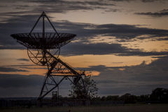 Radio Telescope Silhouette Pointing at the Sky at Dusk Stock Photos