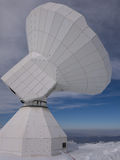 Radio telescope on a snowy peak Royalty Free Stock Image