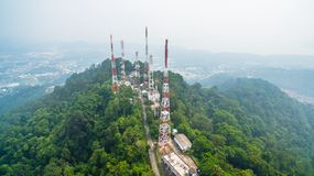 Radio and television Station on the Mountain. Pollution of smoked cloud from wild fire in Sumatra island Indonesia cover radio and television Station on the royalty free stock photos
