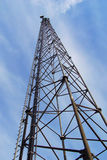 Radio Tower. Vertical view looking up at a tall, modern radio and communications tower stock photo