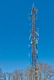 Radio Tower. Radio and telecommunications transmission tower in a suburban neighborhood royalty free stock image