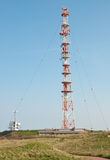 Radio tower. A radio tower with green hills stock images