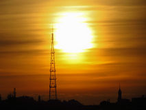 Radio tower. At sunset in city royalty free stock photography