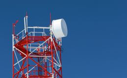 Radio tower. On a background of the blue sky stock photos