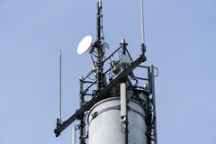 Radio tower. With antennas over blue sky Stock Photography