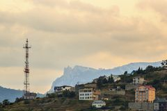 Radio tower and a building in the mountains at Royalty Free Stock Photos