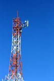 Radio Tower. Communications tower against stark blue sky Royalty Free Stock Photo