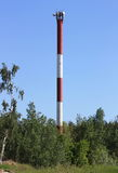 Radio Tower. Derrick radio tower on the edge of the forest Stock Photo