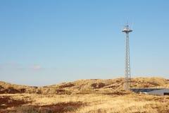 Radio tower between dunes 2 Royalty Free Stock Photography