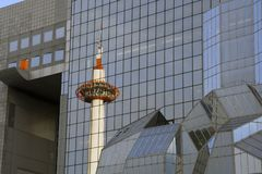 The radio tower in Kyoto is reflected in the facade of the station building royalty free stock photos