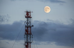 Radio tower and a moon. On the island of Helgoland Stock Photos