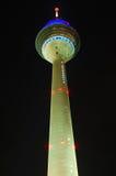 Radio tower by night. Illuminated radio tower by night stock images