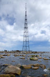 Radio tower on sea coast Royalty Free Stock Photography