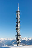 Radio Tower on a Snowy Mountain Summit Royalty Free Stock Photo