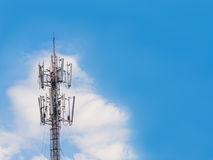 Radio tower with white clouds and blue sky. Royalty Free Stock Photos