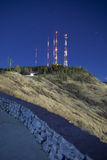 Radio towers at night. Time exposure of radio towers on mountain at night Royalty Free Stock Images