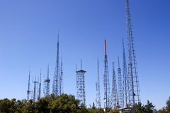 Radio towers in the sky. A group of radio towers pointing upwards toward the blue sky Stock Photography